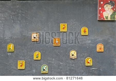 Phuket, TH-Sept,23 2014:Wall with pictures depicting the femail toilet in Botanical Garden in Phuket