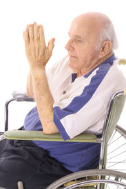 handicap senior praying in wheelchair