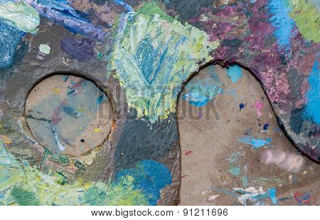 artist's palette with oil paints can be used as background poster