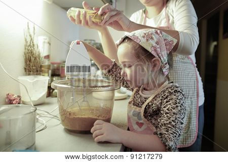 Mother and daughter spending quality time together in the kitchen preparing dough for homemade birthday cake. Family values inclusion learning through experience concept. poster