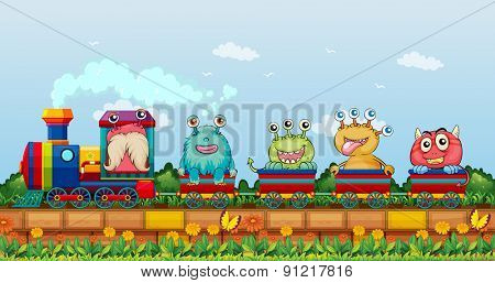 Monsters riding on a train in the park
