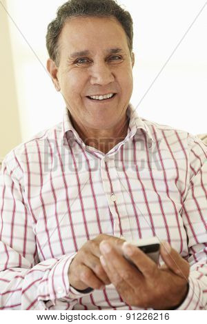 Senior Hispanic Man Using Smartphone
