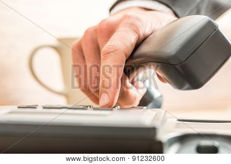 Business Adviser Dialing Out On A Land Line Telephone