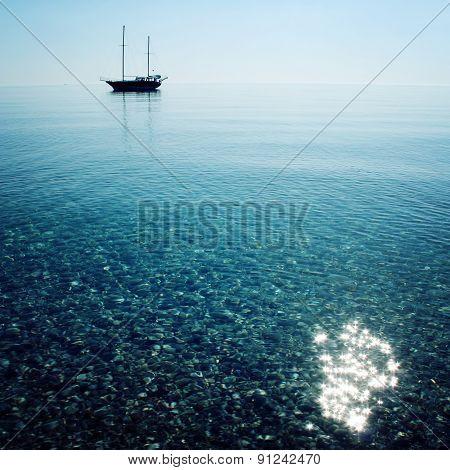 Calm Sea With A Sailing Vessel. Morning. Sailing Ship Profile.