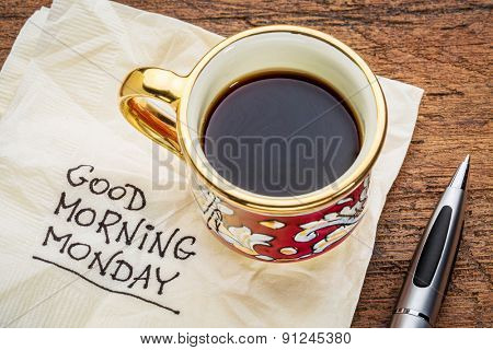 Good morning, Monday - handwriting on a napkin with a cup of coffee