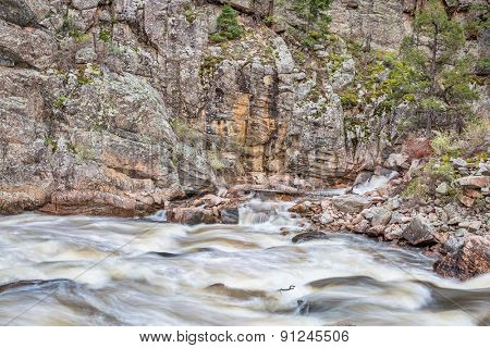Cache la Poudre River at Big Narrows west of  Fort Collins in northern Colorado - springtime scenery with a snow melt run off