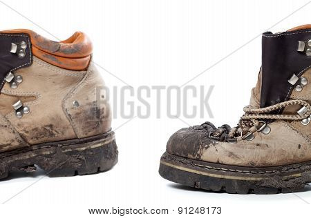 Old Dirty Hiking Boots On White Background