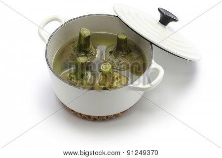 carciofi alla Romana, Roman style boiled artichokes in cast iron casserole