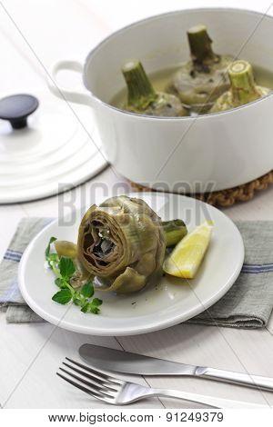 carciofi alla Romana, Roman style boiled artichokes on table