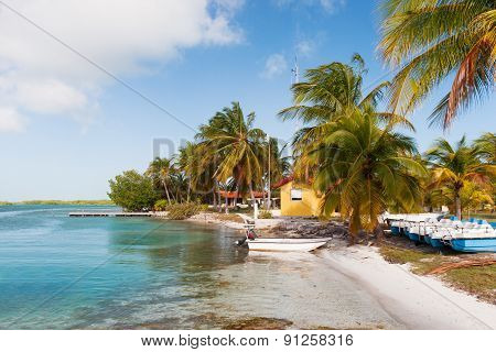 ?oast Of One Of The Islands Of Cuba - Sea, Boats, Palms And Bungalow.