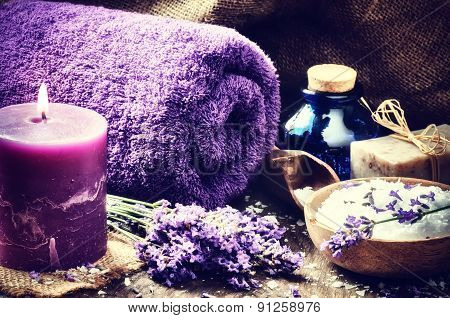 Spa Setting With Candle And Lavender Flowers