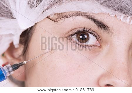 Close up portrait of girl getting injection in face