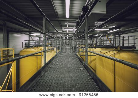 Industrial interior with welded silos