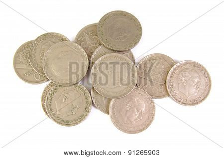 Bunch of old Spanish coins of 50 pesetas showing Franco dictator face on a white background. 1957