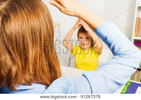 Boy putting hands together like therapist sitting