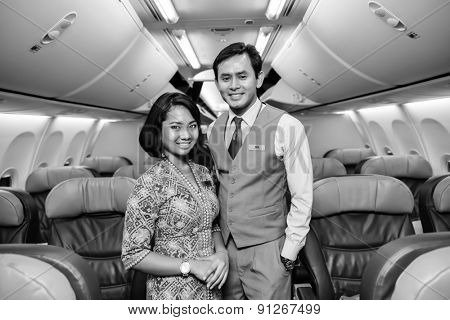 KUALA LUMPUR, MALAYSIA - APRIL 23, 2014: Malaysian Airline crew members posing in Boeing 737 aircraft after landing on April 23, 2014. Malaysian Airline System is the flag carrier airline of Malaysia
