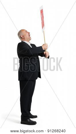 sideview of screaming senior businessman holding placard with stop sign. isolated on white background