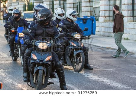 ATHENS, GREECE - APR 16, 2015: Riot police on motorcycles during a rally in front of the Athens University, which is under occupation by the protesters and leftist anarchist groups.