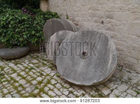 Olive oil millstones in Trogir in Croatia