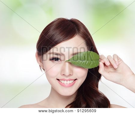 beautiful woman face portrait with green leaf concept for skin care or organic cosmetics asian beauty poster
