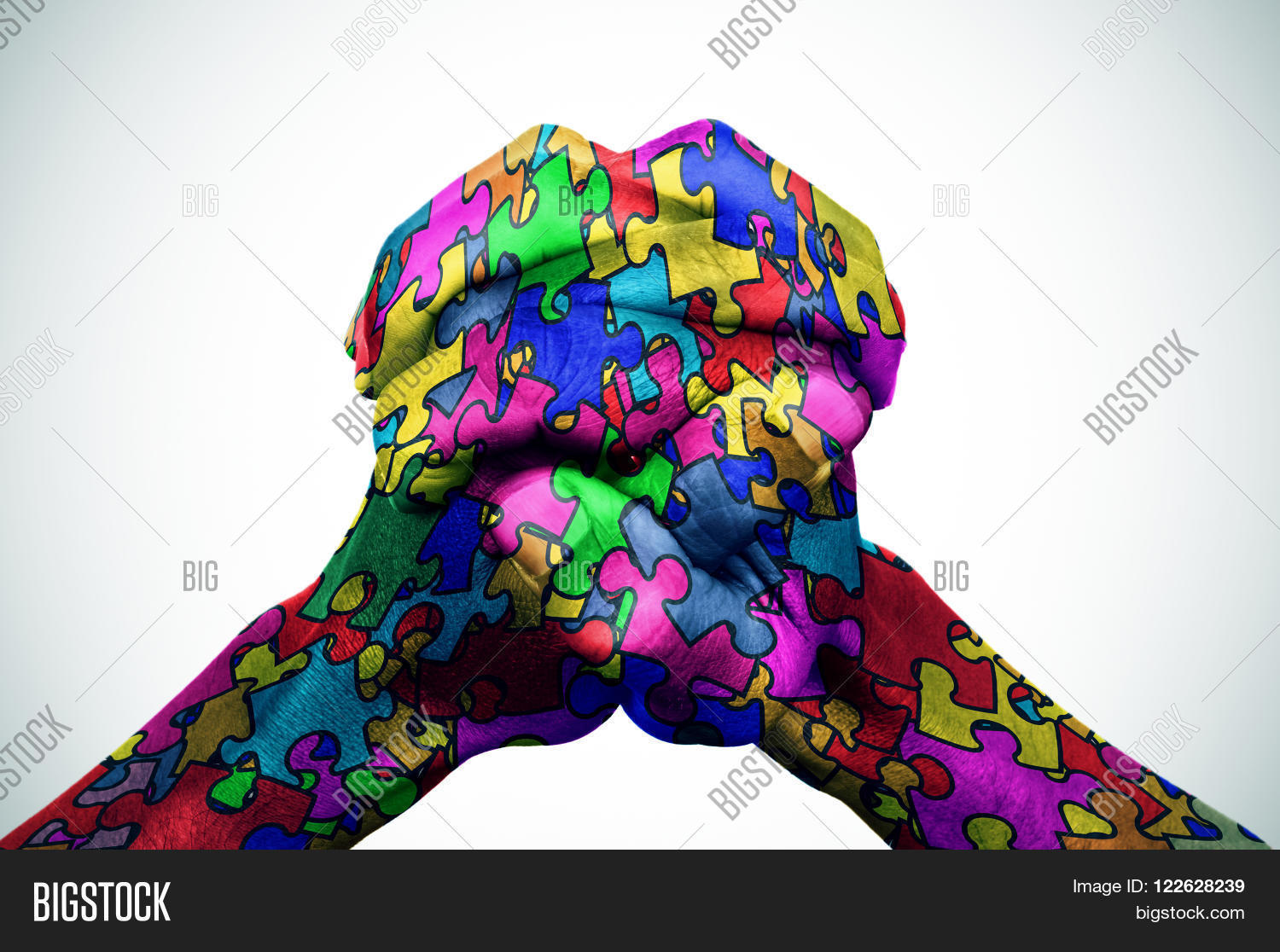Man hands put together patterned image photo bigstock man hands put together patterned with many puzzle pieces of different colors symbol of the biocorpaavc