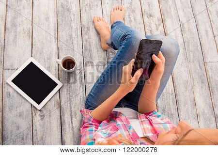 Top View Photo Of Woman With Phone, Tablet And Cup Of Coffee