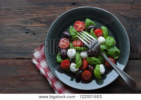 Green Basil with Tomatoes,Olives on the plate with fork