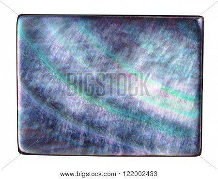 macro shooting - rectangular bead from abalon nacre mineral gemstone isolated on white background