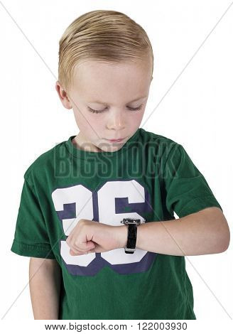 Young boy watching the time on his wristwatch. What time is it.