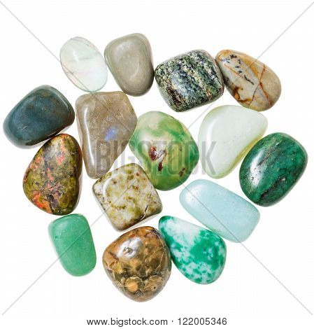 pile of green natural mineral gemstones isolated on white background