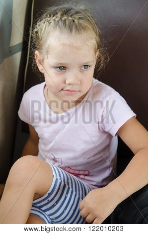 Sad Girl Sitting On A Chair In An Electric Train
