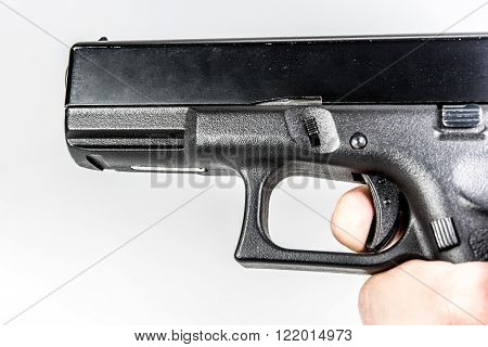 finger position of shot black color gun holding in hand isolated on white background