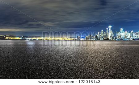 asphalt road with cityscape of seattle at night