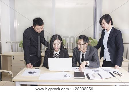 Business people looking at the computer screen to discuss the problem