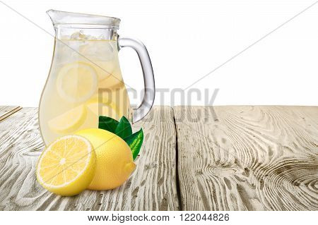 Jug Or Pitcher Of Lemonade With Lemons On Foreground Standin On Wooden Table