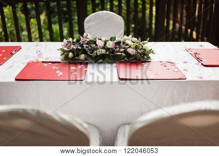 Wedding solemnisation ceremony with table top decorated with flowers.