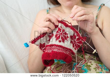 Caucasian woman craftwork knitting with the needle