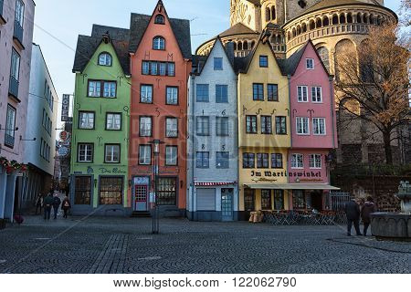 COLOGNE GERMANY - DECEMBER 30 2015: Colorful houses in Old Town on Rhine River Embankment Cologne Germany