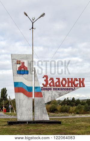 Zadonsk Russia - October 9 2015: Stele at entrance to Zadonsk. It contains the name and emblem of city