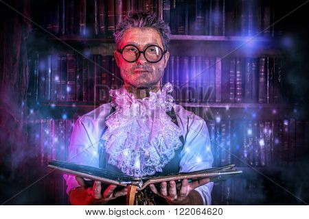Crazy medieval scientist working in his laboratory with old manuscripts. Alchemist. Halloween.