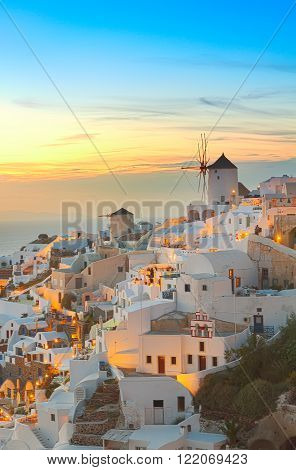 lights of Oia village at evening, Santorini island, Greece.