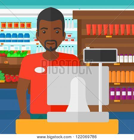 Salesman standing  at checkout.
