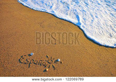 The Spain sign on the sand beach
