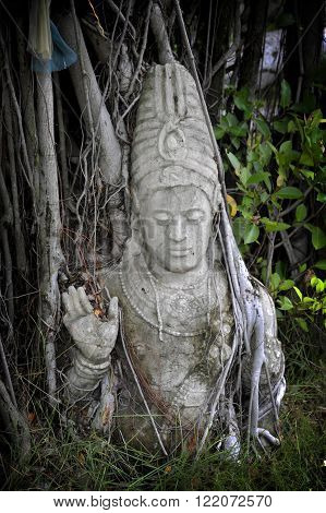 Hindu deity scuplture of the God Vishnu at Ancient Siam near Bangkok. Thailand.