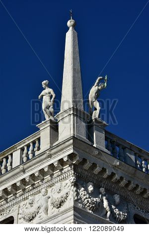 Details and statues from the corner of Biblioteca Marciana (St Mark Library) designed by Jacopo Sansovino in the 16th century in Saint Mark Square