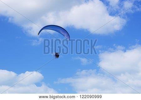 JUMEIRAH BEACH RESIDENCE, DUBAI, UAE - NOVEMBER, 2015: Parachutist, skydiving over Jumeirah Beach