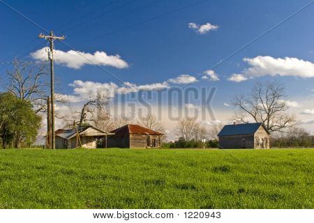 colorful photo of an old farm in rural