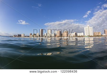 Durban beachfront swimming water view buildings landscape.