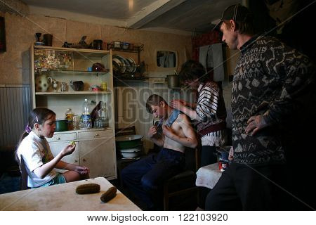 Lipovec village Tver region Russia - May 7 2006: Lipovec village Tver region Russia - May 7 2006: Family Russian farmers in his home four people are in the kitchen of the rural house.