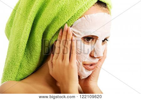 Woman with revitality face mask